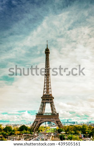 PARIS - NOV 2: The Eiffel Tower on a cloudy day on November 2, 2013.  The Eiffel Tower is one of the most recognizable landmarks in the world, standing 1050 ft tall. - stock photo