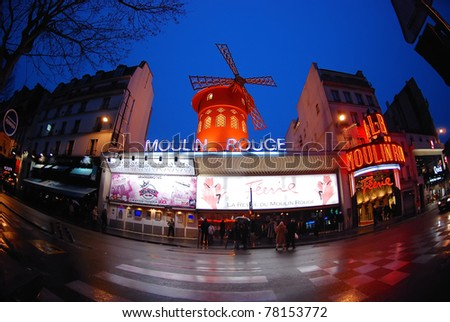 PARIS - NOV 11: The Moulin Rouge has been a famous destination for visitors, locals, and celebrity performances since its opening in 1889. Paris, France, November 11, 2008. - stock photo