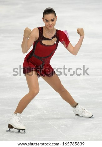 PARIS - NOVEMBER 15, 2013: Adelina SOTNIKOVA of Russia performs during ladies' short skating event at Eric Bompard Trophy 2013 in Palais-Omnisports de Bercy, Paris, France. - stock photo