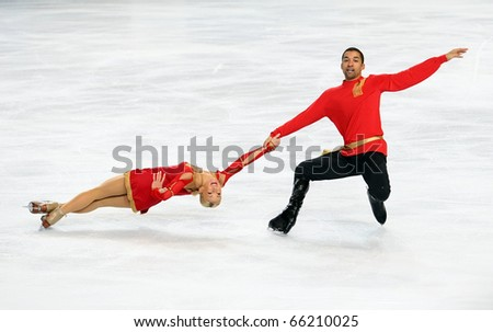 PARIS - NOVEMBER 26: Aliona SAVCHENKO and Robin SZOLKOWY of Germany perform during pairs short skating event at Eric Bompard Trophy on November 26, 2010 at Palais-Omnisports de Bercy, Paris, France. - stock photo