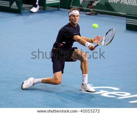 PARIS - NOVEMBER 10: Andreas SEPPI of Italy during 2nd round match against Fernando Verdasco at BNP Paribas Masters, Palais Omnisports de Bercy on November 10, 2009 in Paris, France. - stock photo