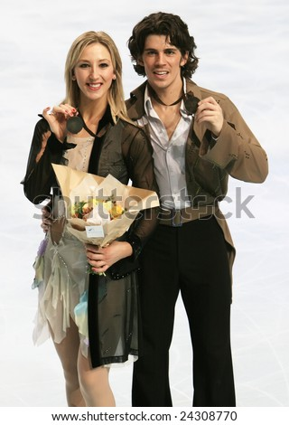 PARIS - NOVEMBER 15: Britain's ice dancers Sinead Kerr / John Kerr pose during medal ceremony at ISU Grand Prix - Eric Bompard Trophy in Bercy, Paris, France on November 15, 2008. - stock photo