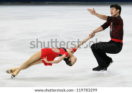 PARIS - NOVEMBER 17: Cheng PENG / Hao ZHANG of China perform during pairs free skating event at Eric Bompard Trophy on November 17, 2012 at Palais-Omnisports de Bercy, Paris, France. - stock photo