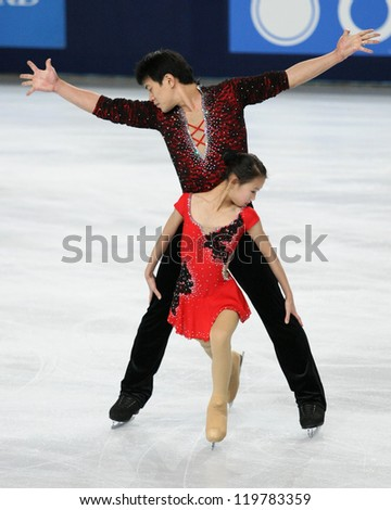 PARIS - NOVEMBER 17: Cheng PENG / Hao ZHANG of China perform during pairs free skating event at Eric Bompard Trophy on November 17, 2012 at Palais-Omnisports de Bercy, Paris, France.