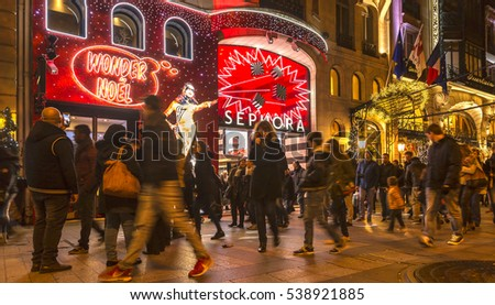 PARIS - NOVEMBER 27: Crowd of people walking in front of Sephora Shop on the famous Champs Elysees Boulevard, during the winter holidays season in Paris on 27 November 2016..