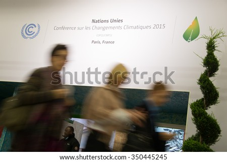 PARIS - NOVEMBER 29: Delegates enter the main hall of the COP21 United Nations climate summit in Paris, France, November 29, 2015. - stock photo