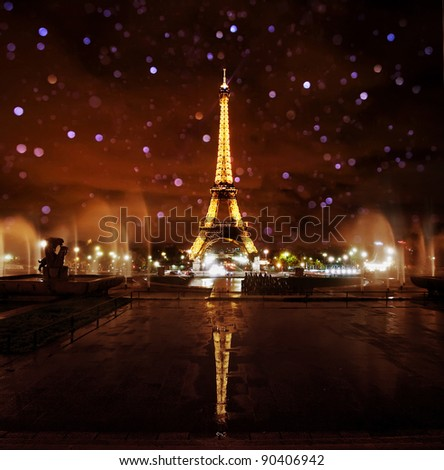 PARIS - NOVEMBER 12: Eiffel Tower at night with blurred water drops on November 12, 2010 in Paris, France. The Eiffel tower is the most visited monument of France with over 6 million visitors a year. - stock photo