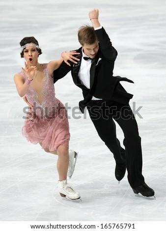PARIS - NOVEMBER 15, 2013: Elena ILINYKH / Nikita KATSALAPOV of Russia perform short dance at Eric Bompard Trophy 2013 in Palais-Omnisports de Bercy, Paris, France. - stock photo
