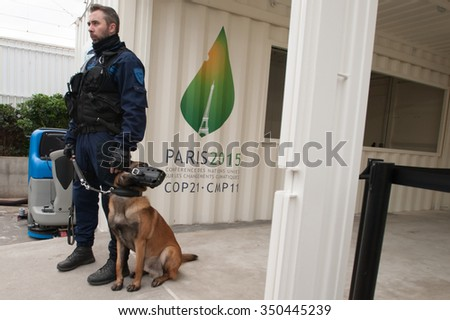 PARIS - NOVEMBER 30: French police stand guard as delegates arrive at the COP21 United Nations climate summit in Paris, France, November 30, 2015. - stock photo