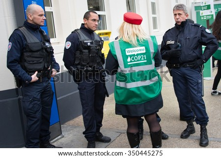 PARIS - NOVEMBER 29: French police stand guard at the Le Bourget metro station as delegates arrive for the COP21 United Nations climate summit in Paris, France, November 29, 2015. - stock photo