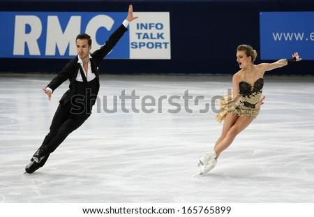 PARIS - NOVEMBER 15, 2013: Gabriella PAPADAKIS / Guillaume CIZERON of France perform short dance at Eric Bompard Trophy 2013 in Palais-Omnisports de Bercy, Paris, France. - stock photo