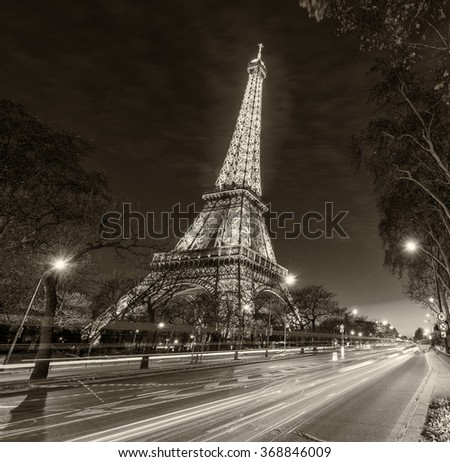PARIS - NOVEMBER 22, 2012: Illuminated Eiffel Tower at dusk. The tower is the most visited landmark of France. - stock photo
