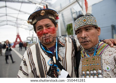 PARIS - NOVEMBER 30: Indigenous Peruvians in traditional dress arrive at the COP21 United Nations climate summit in Paris, France, November 30, 2015. - stock photo
