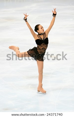 PARIS - NOVEMBER 15: Japanese figure skater Mao Asada  performs during the Ladies free skating event of ISU Grand Prix - Eric Bompard Trophy in Bercy, Paris, France on November 15, 2008. - stock photo