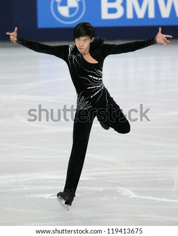 PARIS - NOVEMBER 16: Jinlin GUAN of China performs at men's short skating event at Eric Bompard Trophy on November 16, 2012 at Palais-Omnisports de Bercy, Paris, France. - stock photo