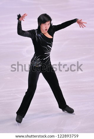 PARIS - NOVEMBER 16: Jinlin GUAN of China performs at men short program event at Eric Bompard Trophy on November 16, 2012 at Palais-Omnisports de Bercy, Paris, France. - stock photo