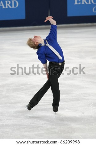 PARIS - NOVEMBER 26: Kevin REYNOLDS of Canada performs at men's short skating event at Eric Bompard Trophy on November 26, 2010 at Palais-Omnisports de Bercy, Paris, France.