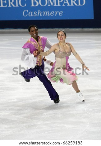 PARIS - NOVEMBER 26: Kharis RALPH / Asher HILL of Canada perform short dance at the ISU Grand Prix Eric Bompard Trophy on November 26, 2010 at Palais-Omnisports de Bercy, Paris, France.