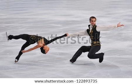 PARIS - NOVEMBER 16: Ksenia STOLBOVA /Fedor KLIMOV of France perform at pairs short program event at Eric Bompard Trophy on November 16, 2012 at Palais-Omnisports de Bercy, Paris, France. - stock photo