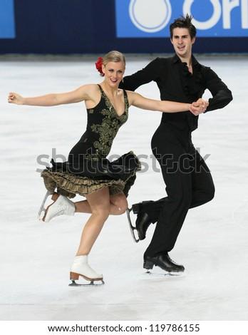 PARIS - NOVEMBER 17: Madison HUBBELL / Zachary DONOHUE of USA perform free dance at the ISU Grand Prix Eric Bompard Trophy on November 17, 2012 at Palais-Omnisports de Bercy, Paris, France. - stock photo