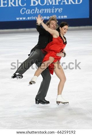 PARIS - NOVEMBER 26: Nathalie PECHALAT and Fabian BOURZAT of France perform short dance at the ISU Grand Prix Eric Bompard Trophy on November 26, 2010 at Palais-Omnisports de Bercy, Paris, France.
