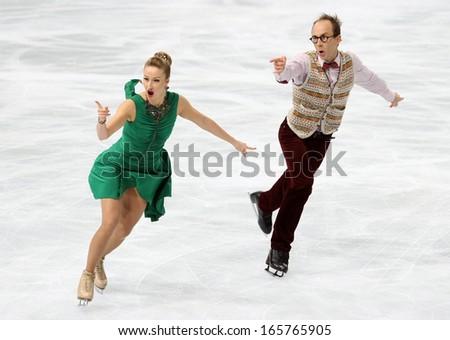 PARIS - NOVEMBER 15, 2013: Nelli ZHIGANSHINA / Alexander GAZSI of Germany perform short dance at Eric Bompard Trophy 2013 in Palais-Omnisports de Bercy, Paris, France. - stock photo