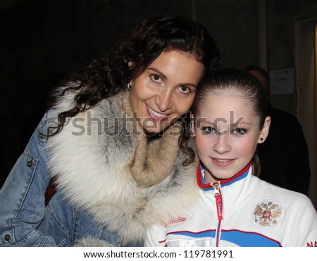 PARIS - NOVEMBER 16: Russian figure skating coach Eteri TUTBERIDZE and her pupil Julia LIPNITSKAIA pose during the ISU Grand Prix Throphee Eric Bompard in Bercy on Novermber 16, 2012 in Paris, France - stock photo