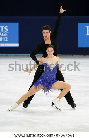 PARIS - NOVEMBER 18: Tessa VIRTUE / Scott MOIR of Canada perform short dance at the ISU Grand Prix Eric Bompard Trophy on November 18, 2011 at Palais-Omnisports de Bercy, Paris, France.