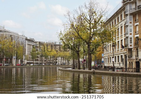 PARIS - NOVEMBER 27: The Canal Saint-Martin is a 4.5 km long canal in Paris. View to the canal and city life in an autumn time on November 2014, Paris. - stock photo