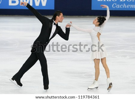 PARIS - NOVEMBER 16: Yuko KAVAGUTI / Alexander SMIRNOV of Russia perform during pairs short skating event at Eric Bompard Trophy on November 16, 2012 at Palais-Omnisports de Bercy, Paris, France. - stock photo