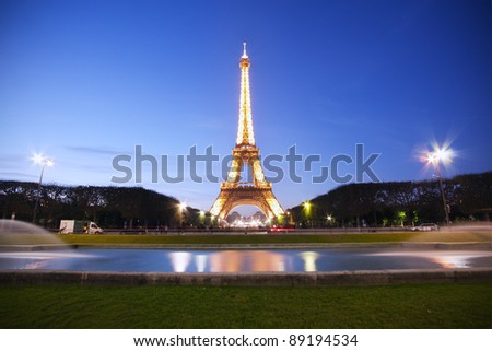 PARIS - OCT 22: Eiffel Tower light show at dusk on October 22, 2011 in Paris, France. Eiffel Tower is the highest and most visited monument in France and use 20,000 light bulbs in the night show. - stock photo