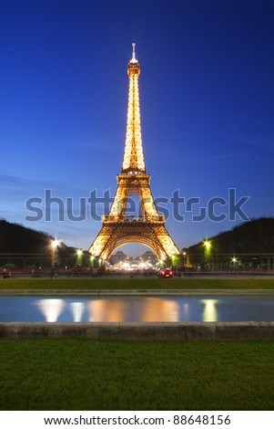 PARIS - OCT 22: Eiffel Tower light show seen from Champ de Mars on October 22, 2011 in Paris, France. Eiffel Tower is the most visited monument in France and use 20,000 light bulbs in the show. - stock photo