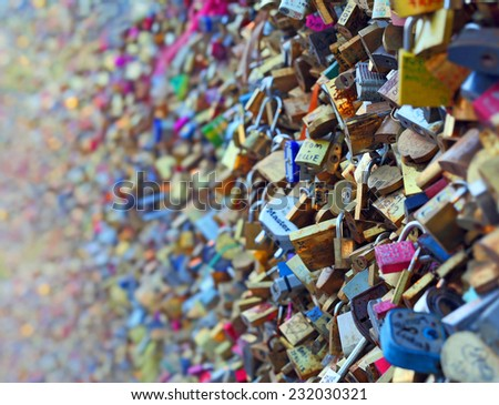 PARIS - OCT 18: Lockers at Pont des Arts symbolize love for ever, October 18, 2014 in Paris. 16000 lockers of loving couples are on that bridge, also known as Passarelle des Arts.  - stock photo