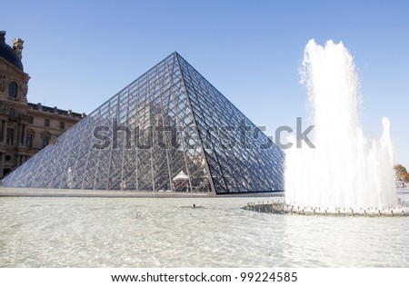PARIS - OCT 10: Louvre pyramid on October 2010, Paris, France. Louvre is the biggest Museum in Paris displayed over 60,000 square meters of exhibition space. - stock photo