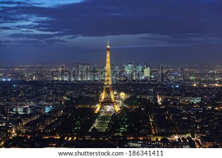 PARIS - OCTOBER 17, 2014: A panoramic shot of the Eiffel Tower taken from the Montparnasse Tower at night in Paris, France on Oct 17th 2014 - stock photo