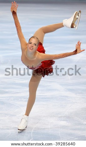 PARIS - OCTOBER 16: Carolina KOSTNER of Italy performs at ladies short skating event Eric Bompard Trophy at Palais-Omnisports de Bercy October 16, 2009 in Paris, France. - stock photo