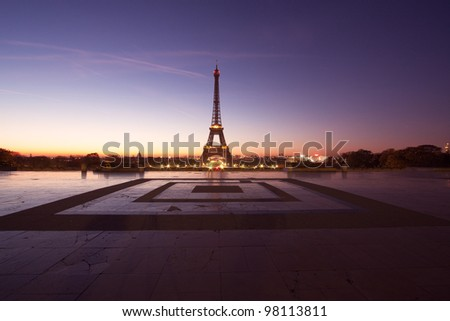 PARIS - OCTOBER 21: Eiffel Tower light show at dawn on October 21, 2011 in Paris, France. Eiffel Tower is the highest and most visited monument in France and use 20,000 light bulbs in the night show. - stock photo