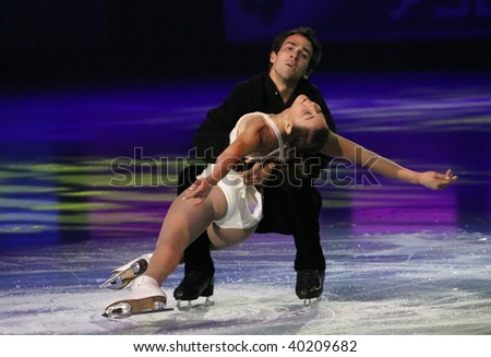 PARIS - OCTOBER 18: Jessica DUBE and Bryce DAVISON of Canada perform at the Gala event of the ISU Grand Prix Eric Bompard Trophy at Palais-Omnisports de Bercy October 18, 2009 in Paris, France. - stock photo
