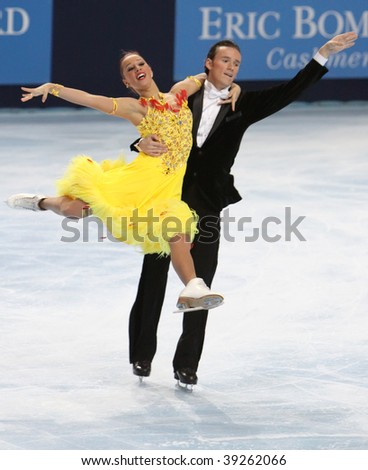 PARIS - OCTOBER 16: Kristina GORSHKOVA and Vitali BUTIKOV of Russia perform compulsory dance at Eric Bompard Trophy at Palais-Omnisports de Bercy October 16, 2009 in Paris, France. - stock photo