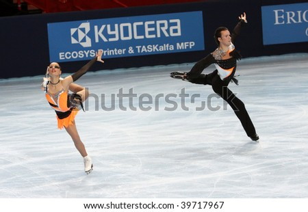 PARIS - OCTOBER 17: Kristina GORSHKOVA and Vitali BUTIKOV of Russia perform free dance at the ISU Grand Prix Eric Bompard Trophy at Palais-Omnisports de Bercy October 17, 2009 in Paris, France. - stock photo