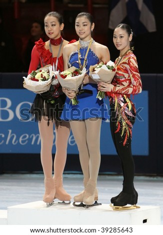 PARIS - OCTOBER 17: Mao ASADA (L), Yu-Na KIM (C) and Yukari NAKANO (R) during medal ceremony  Eric Bompard Trophy at Palais-Omnisports de Bercy October 16, 2009 in Paris, France. - stock photo