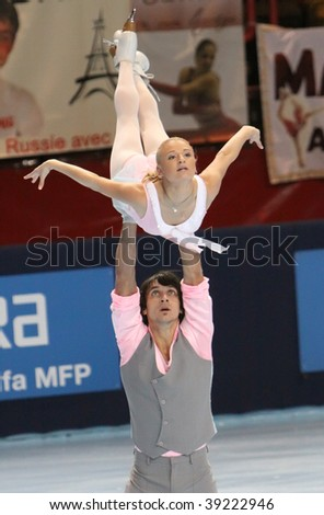 PARIS - OCTOBER 17: Maria Mukhortova and Maxim Trankov of Russia during pairs free skating event at Eric Bompard Trophy at Palais-Omnisports de Bercy October 17, 2009 in  Paris, France. - stock photo