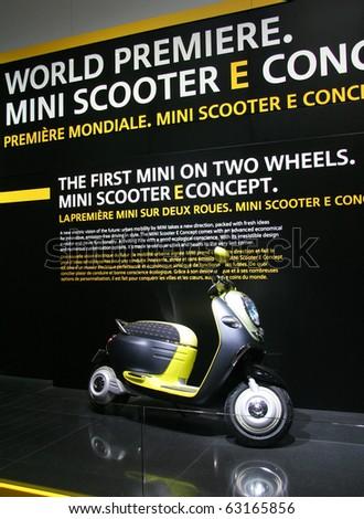 PARIS - OCTOBER 11: Mini Scooter E Concept is displayed at the Paris Motor Show 2010 at Porte de Versailles, on October 11, 2010 in Paris, France - stock photo