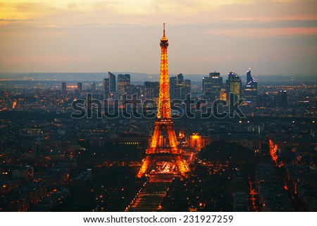 PARIS - OCTOBER 11: Paris cityscape with Eiffel tower on October 11, 2014 in Paris, France. It's an iron lattice tower located on the Champ de Mars and  was named after the engineer Gustave Eiffel. - stock photo