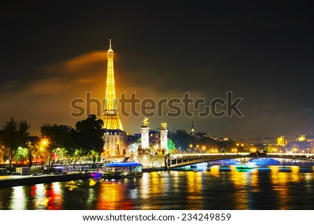 PARIS - OCTOBER 12: Paris cityscape with Eiffel tower on October 12, 2014 in Paris, France. It's an iron lattice tower located on the Champ de Mars and  was named after the engineer Gustave Eiffel. - stock photo