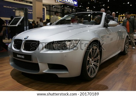 PARIS - OCTOBER 13 : People look at the Bmw m3 roadster at the 2008 Paris Motor Show October 13, 2008 in Paris. The show attracts more of one million people every 2 years