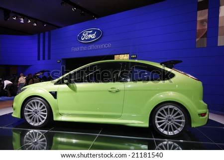 PARIS - OCTOBER 13 : People look at the Ford Focus RS at the 2008 Paris Motor Show October 13, 2008 in Paris.