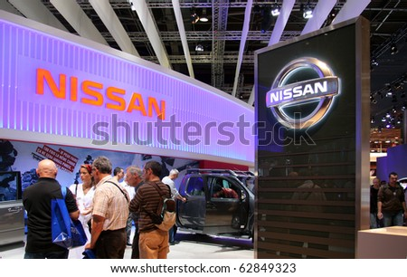 PARIS - OCTOBER 11: People visit the Nissan stand at the Paris Motor Show 2010 at Porte de Versailles, on October 11, 2010 in Paris, France - stock photo