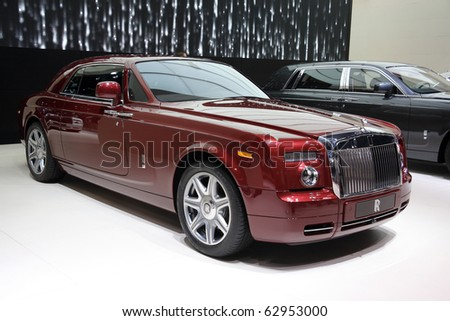 PARIS - OCTOBER 11: Rolls-Royce Phantom Coupe in Syrah Red metallic with Bespoke design is displayed at the Paris Motor Show 2010 at Porte de Versailles, on October 11, 2010 in Paris, France - stock photo
