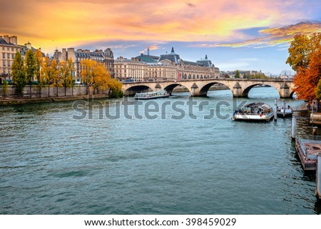 PARIS - October 25:Seine River in Paris, France in autumn.  Paris is one of the most visited cities in the world with about 28 million of visitors every year./Seine River in Paris, France in autumn. - stock photo
